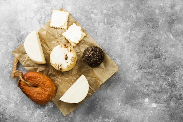 Various types of cheese on a gray background. top view, copy space.