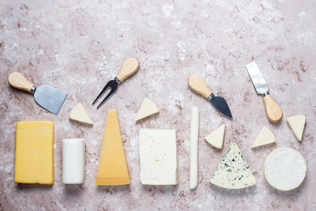 Various types of cheese on light  brown surface
