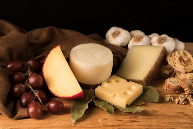 Various types of cheeses on kitchen counter