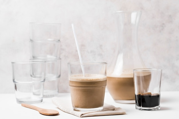 Various types of coffee glass containers and coffee with milk