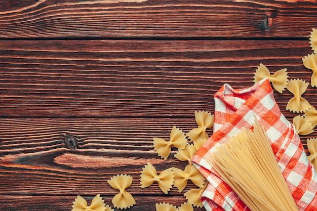 Various types of italian pasta rustic background