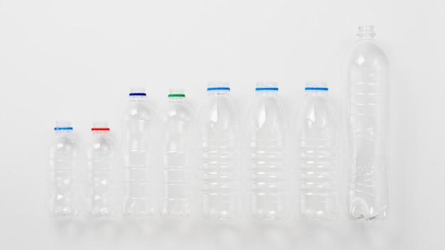 Various types of plastic bottles on grey background