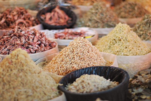 Various types of salted fish in market stalls