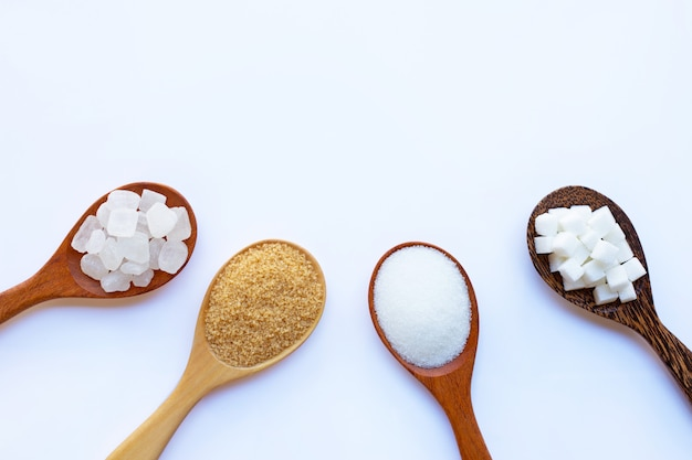 Various types of sugar on white.