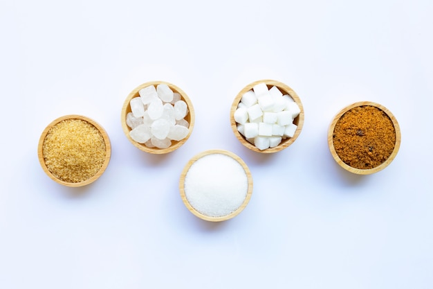 Various types of sugar on white.