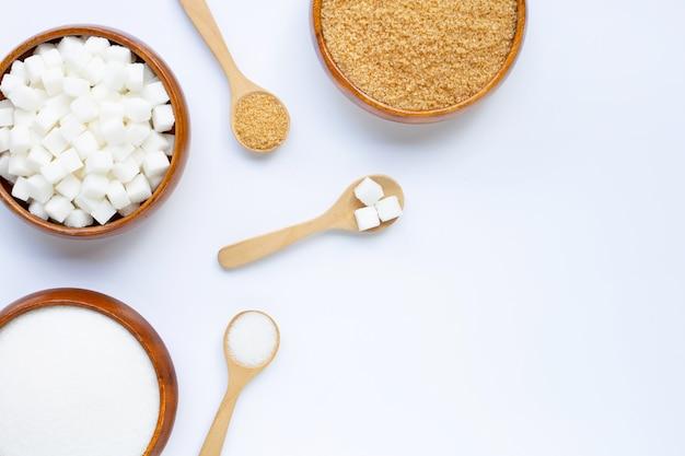 Various types of sugar on white .