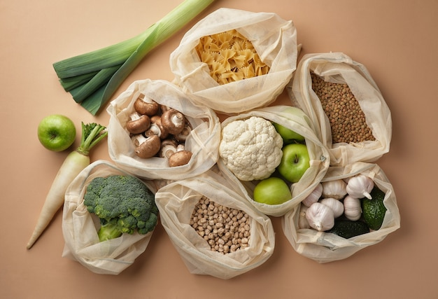 Various vegetables pasta mushrooms and cereals in reusable fabric eco bags