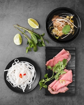 Various vietnamese food with noodles and ham