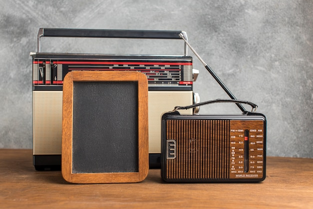 Variousvintage radios on wooden table copy space