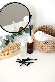 Various wellness and spa treatment products on white background. zero waste natural cosmetics on a dressing table.