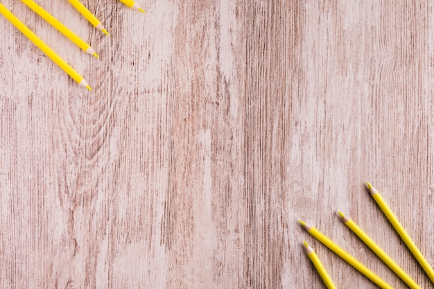 Various yellow pencils on desk