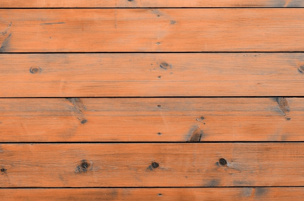 Varnished wood from cabin exterior. brown wood barn plank