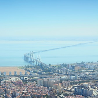 The vasco da gama bridge is a cable-stayed bridge flanked by viaducts and rangeviews in lisbon, the capital of portugal