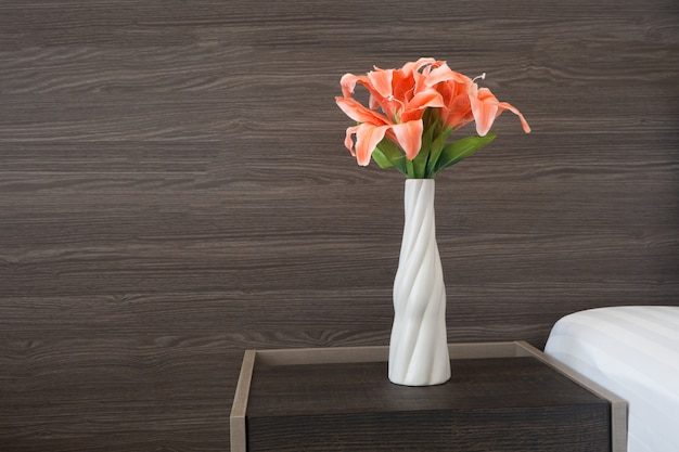 Vase of flower on wood table.