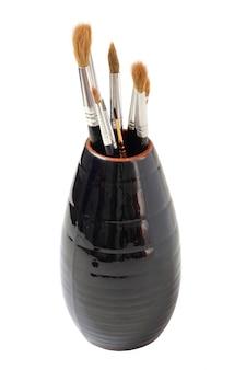 アーティストのブラシが付いている花瓶