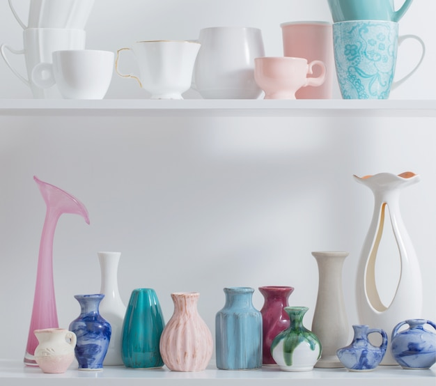 Vases on white shelf