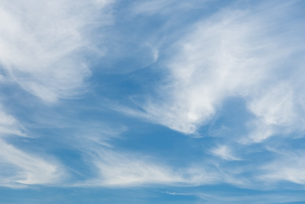 Vast fluffy clouds on blue sky