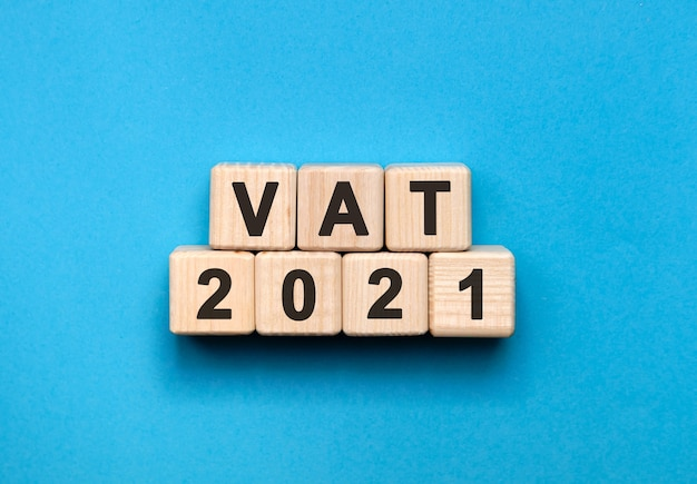 Vat - text concept on wooden cubes with gradient blue background
