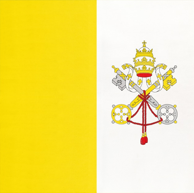 Vatican national fabric flag, textile background. italy state official sign.