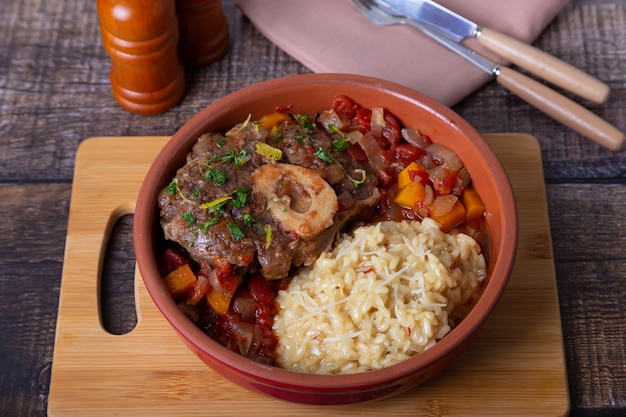 Veal (beef) shanks with saffron risotto in milanese, gremolata and sauce.