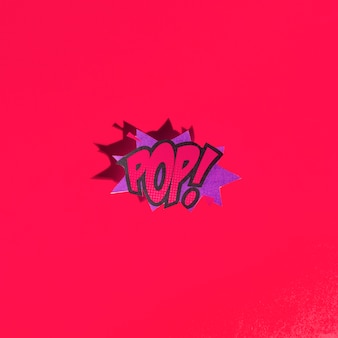 Vector pop art bright speech bubble in comic style on red background