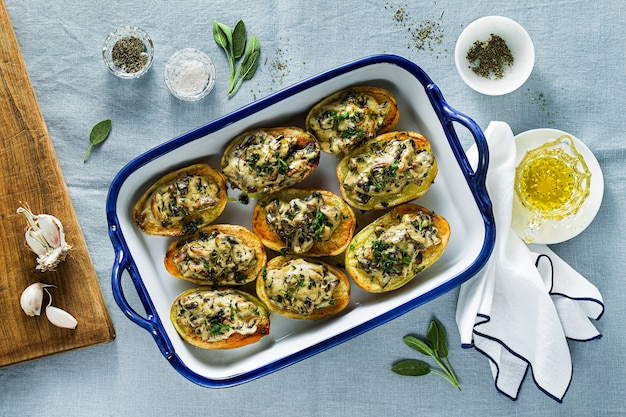 Vegan baked potatoes with mushrooms in bechamel sauce with soy milk. healthy lunch or dinner for the family