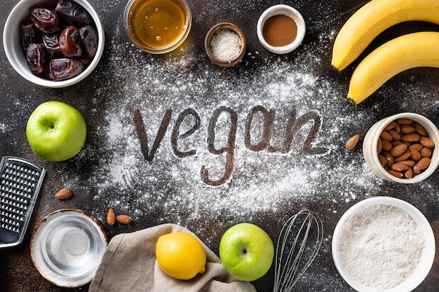 Vegan baking ingredients, utensils and word vegan