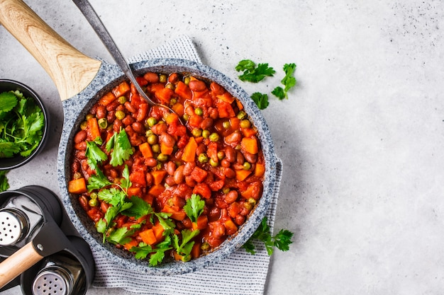 Vegan bean stew with tomatoes in a pan