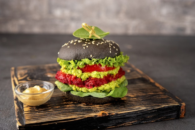 Vegan black burger with avocado and beet patty