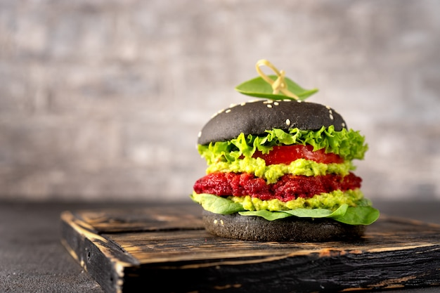 Vegan black burger with avocado and beet patty