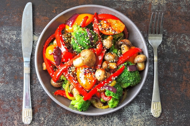 Vegan bowl with warm vegetable and mushroom salad. keto lunch idea. broccoli, paprika, mushrooms. healthy fresh food without meat.