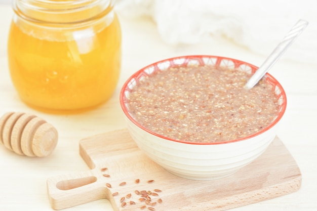 Vegan breakfast. porridge from flaxseed honey. raw food meal.
