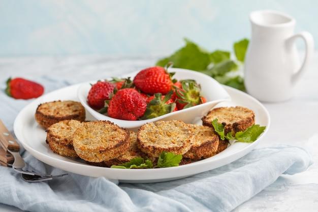 Vegan breakfast sweet tofu fritters (pancakes) with strawberries. healthy vegan food concept.