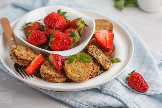 Vegan breakfast sweet tofu fritters with strawberries.