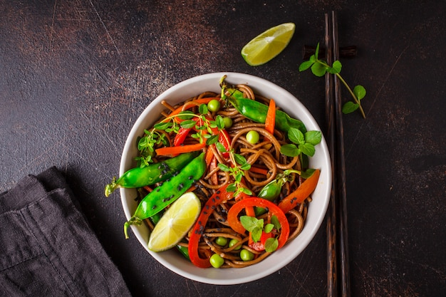 Vegan buckwheat soba noodles with vegetables , top view.