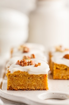 Vegan carrot cake with coconut cream and pecan, plant based diet concept.