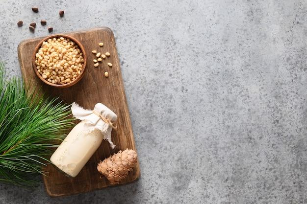 Vegan cedar nut milk in bottle on gray background non dairy alternative milk healthy vegetarian drin...