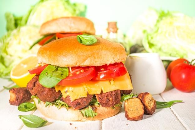 Vegan cheeseburger with roasted falafel, israeli traditional food