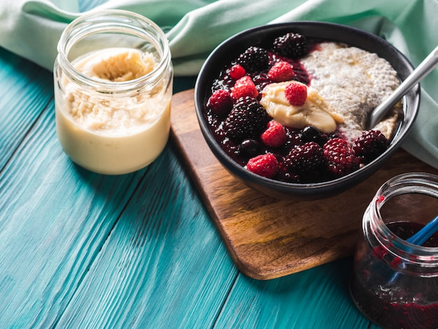 Vegan chia pudding with berries and almond butter