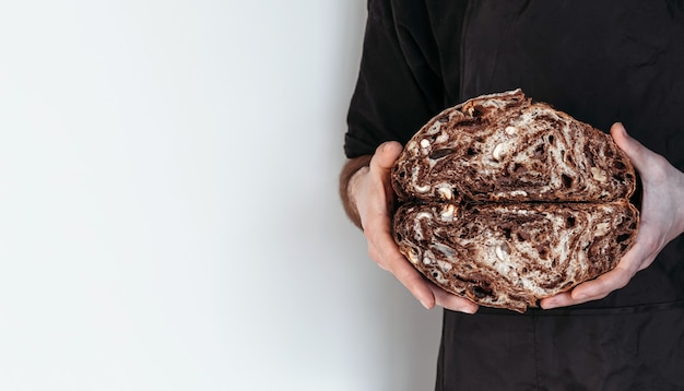 Vegan chocolate bread in hands of baker. gluten-free and without animal products.
