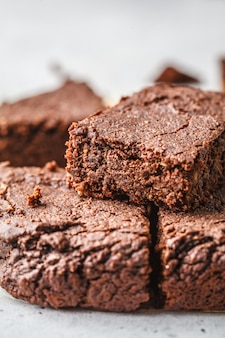 Vegan chocolate brownies on white background.
