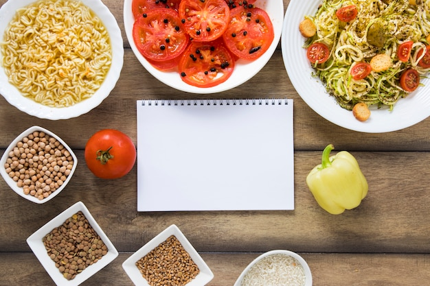 Vegan dishes with notebook mock-up