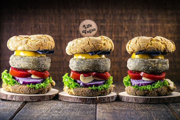 Vegan hamburger, with soy-based hamburger. wooden sign written in english  life vegan