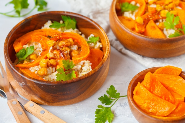 Vegan healthy bowl with brown rice, baked pumpkin and chickpeas. vegetarian food concept.