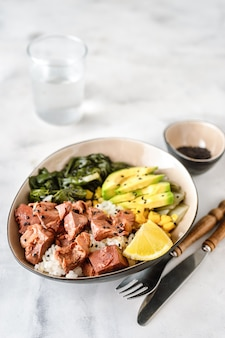 Vegan healthy bowl with rice, salad and jackfruit on dark backround
