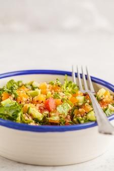 Vegan healthy rainbow salad with quinoa, tofu, avocado and kale.