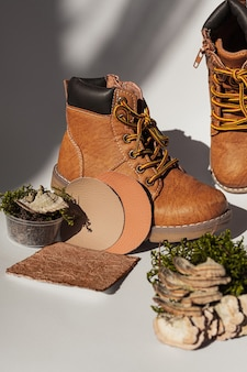 Vegan leather shoes from mushroom mycelium and samples of vegan bio leather, eco friendly concept