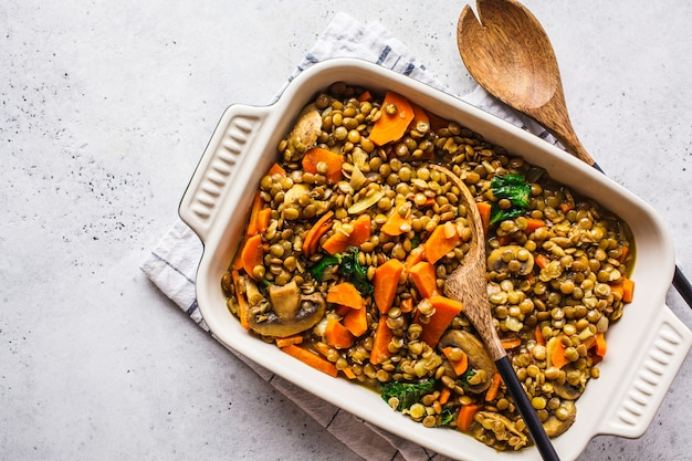 Vegan lentil curry with vegetables, top view. healthy plant based food background.