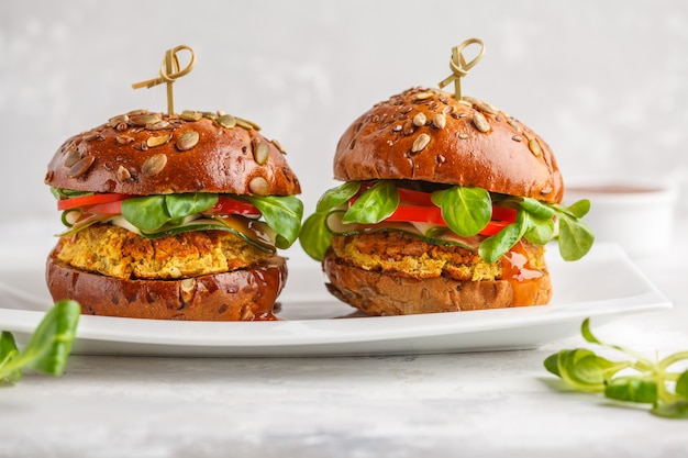 Vegan lentils burgers with vegetables and curry sauce on white dish. healthy vegan food concept.