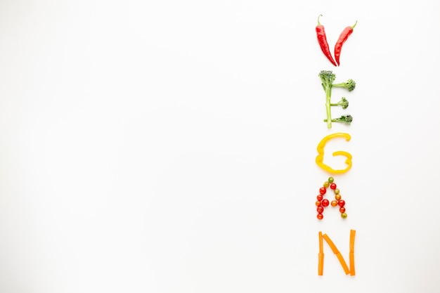 Vegan lettering made out of vegetables with copy space